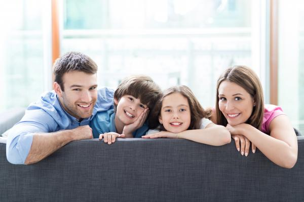 Bigstock Family Relaxing On Sofa 90746753