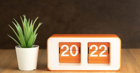 Retro Flip clock with 2022 number on wooden table - Decorating Trends in New Zealand for 2021